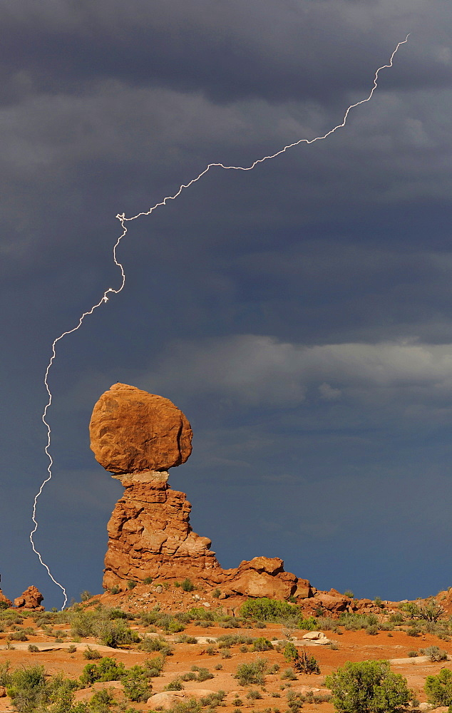 Balanced Rock, rock formation, thunderstorm clouds, lightning, Arches National Park, Moab, Utah, Southwestern United States, United States of America, USA
