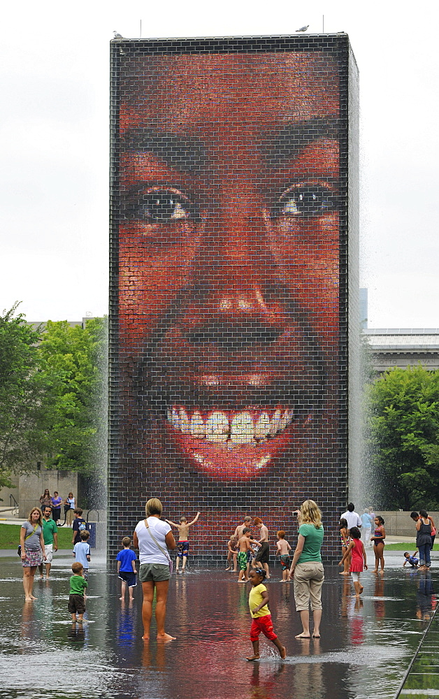 Children having fun with the water fountains of Crown Fountain, Millennium Park, Chicago, Illinois, United States of America, USA