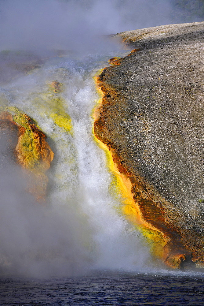 Runoff from Excelsior Geyser into Firehole River, Midway Geyser Basin, colored thermophilic bacteria, microorganisms, geysers, hot springs, Yellowstone National Park, Wyoming, United States of America, USA