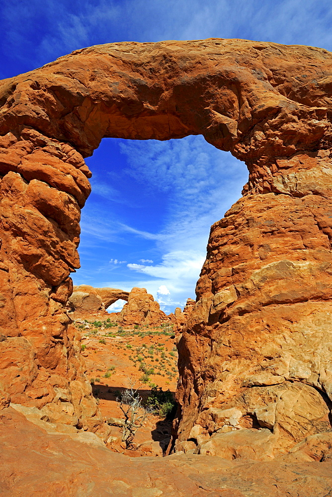 Looking through the Turret Arch towards the South Window, Arches National Park, Utah, USA