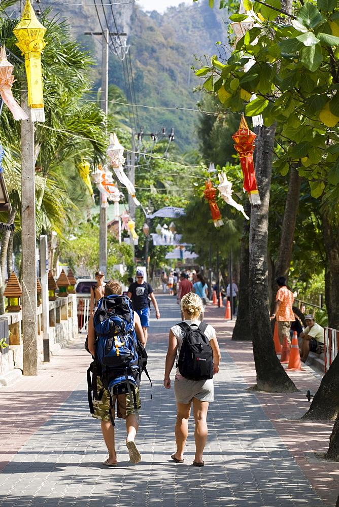 Backpackers walking along the boulevard of Ao Nang, Krabi Province, Thailand, Asia