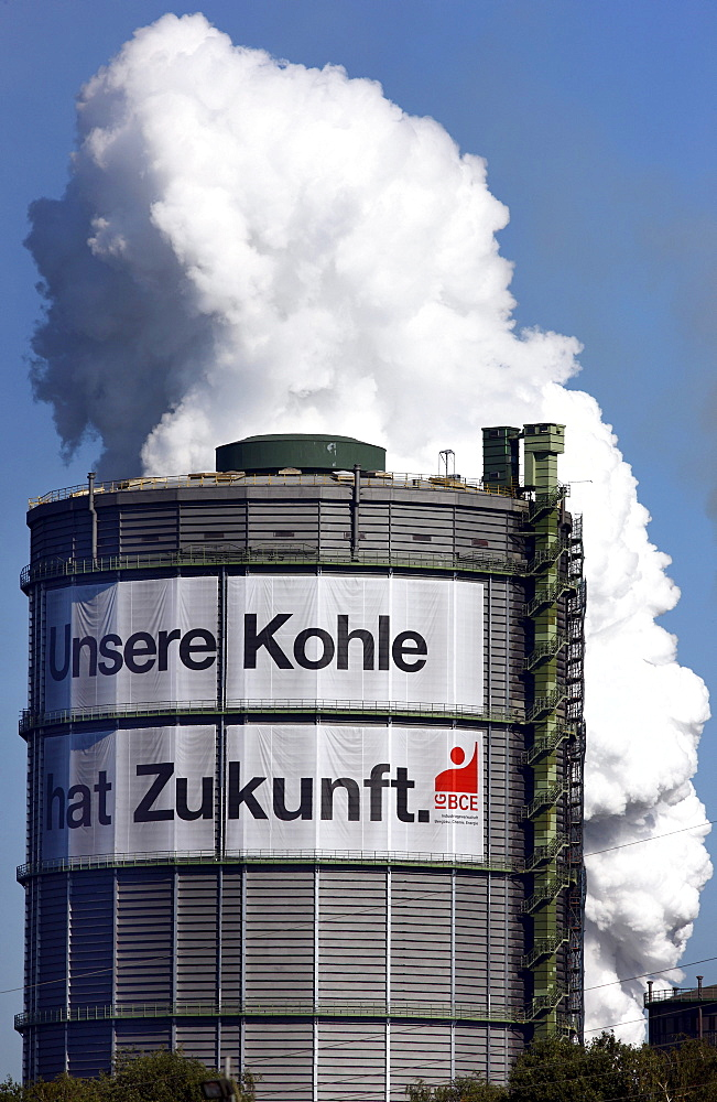 "Gas holder, Kokerei Prosper coking plant with a large poster of the IGBCE trades union with a lettering ""Unsere Kohle hat Zukunft"", German for ""Our coal industry has a future"", protest against the closure of coal plants in Germany and the reduction of sub"