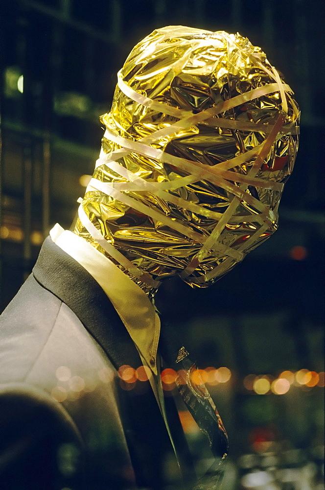Male mannequin, head wrapped in gold paper, Koenigsallee, Duesseldorf, North Rhine-Westphalia, Germany, Europe