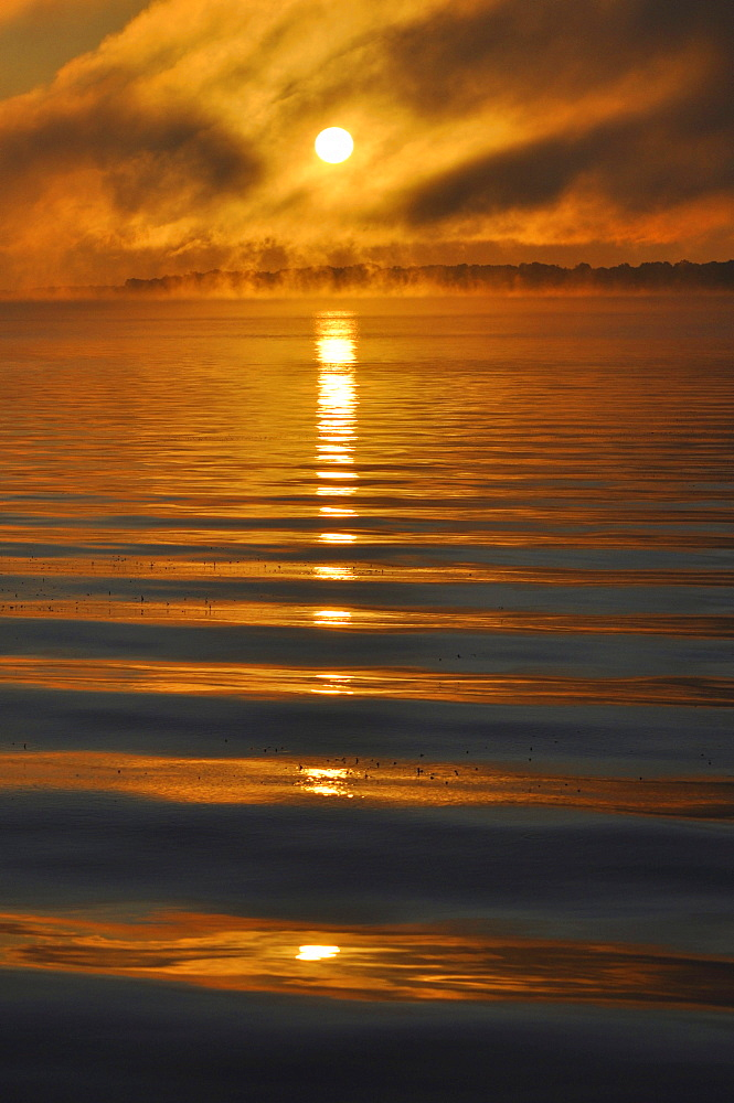 Sun reflected in waves, Pewaukee Lake, Wisconsin, USA, America