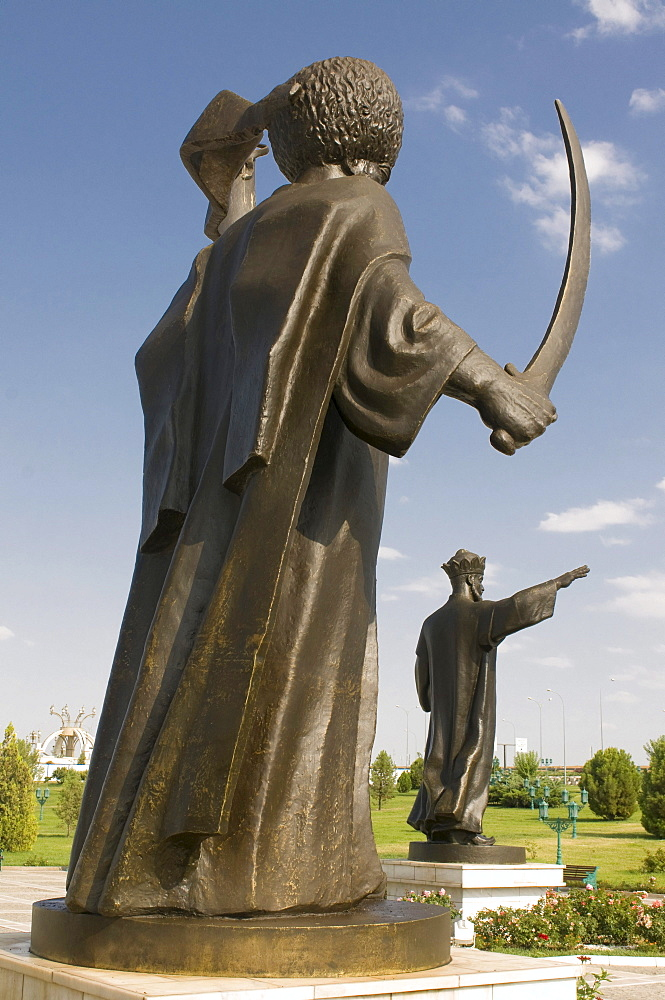 Statue with a sword in front of the Independence Monument of Turkmenistan, Ashgabat, Turkmenistan, Central Asia
