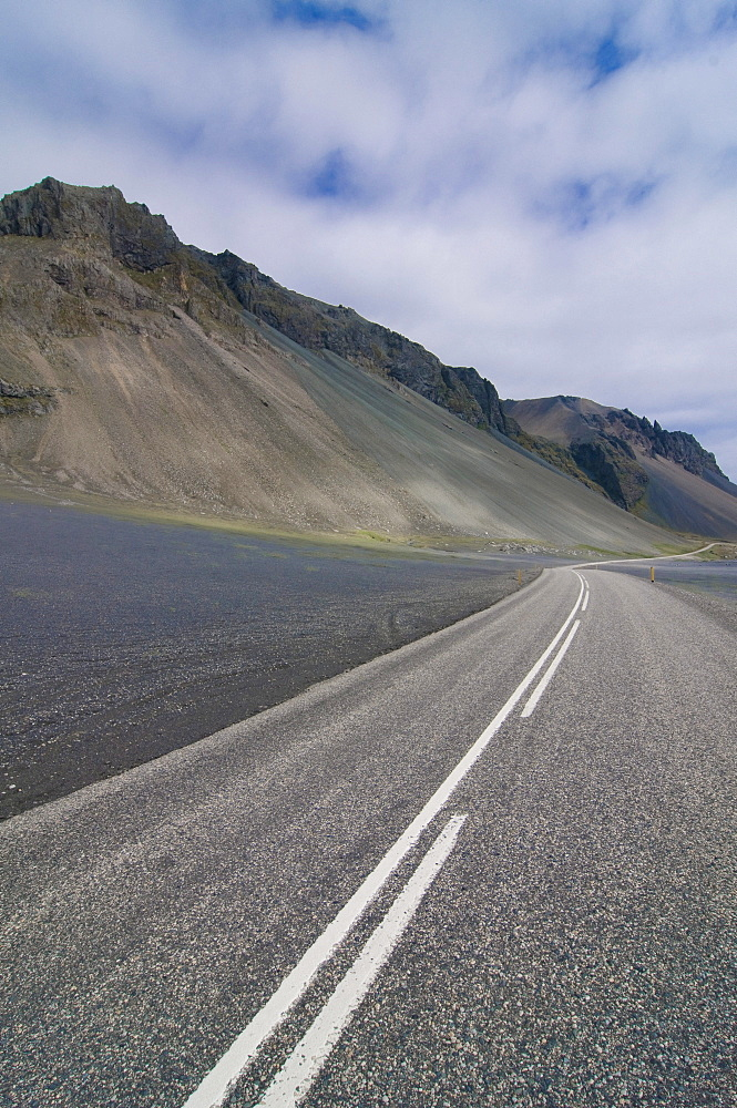 Country road leading into wilderness, Eastern Coast, Iceland, Europe