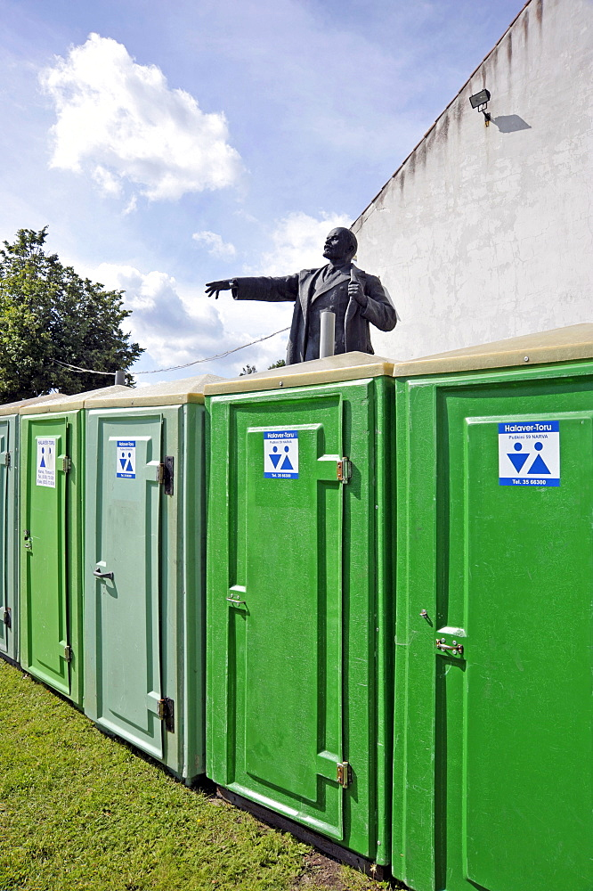 Lenin, Lenin monument standing near chemical toilets in the courtyard of the Hermann Fortress, Narva, Estonia, Baltic States, Northern Europe