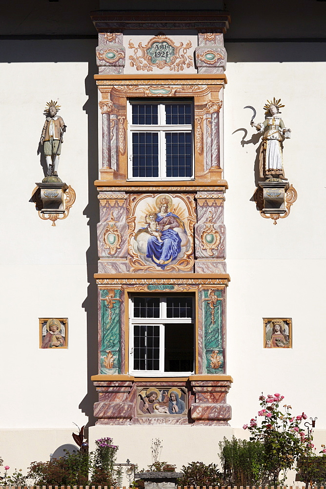 Bay window with mural paintings called Lueftlmalerei, villa built in Bavarian country house style in 1921, Fruehlingstrasse street, Garmisch district, Garmisch-Partenkirchen, Werdenfelser Land region, Upper Bavaria, Bavaria, Germany, Europe