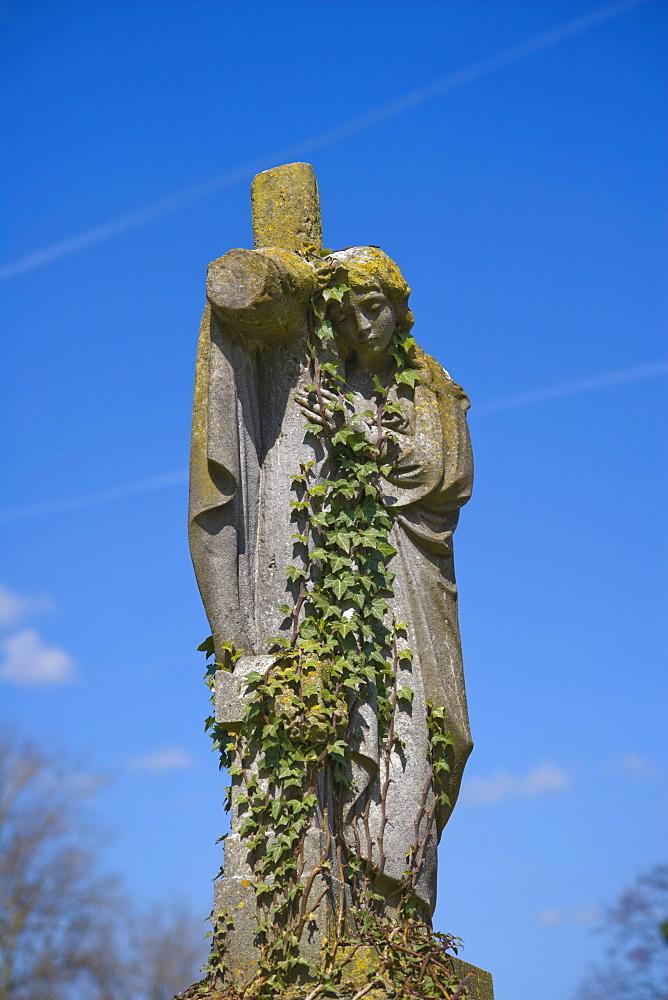Gravestone of angel holding cross, St Mary's graveyard, Andover, Hampshire, England, United Kingdom, Europe