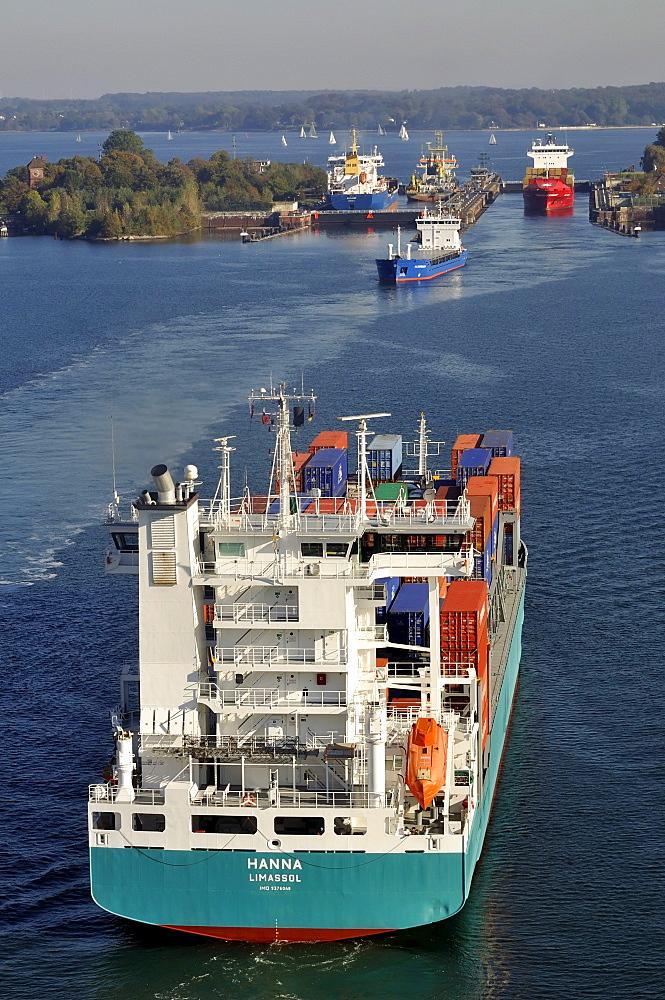 Shipping container ships at Holtenau lock, Kiel Canal, Kiel, Schleswig-Holstein, Germany, Europe