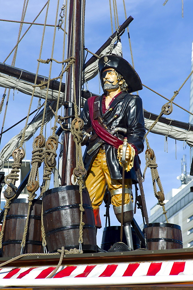 Statue of a pirate on an old sailing ship