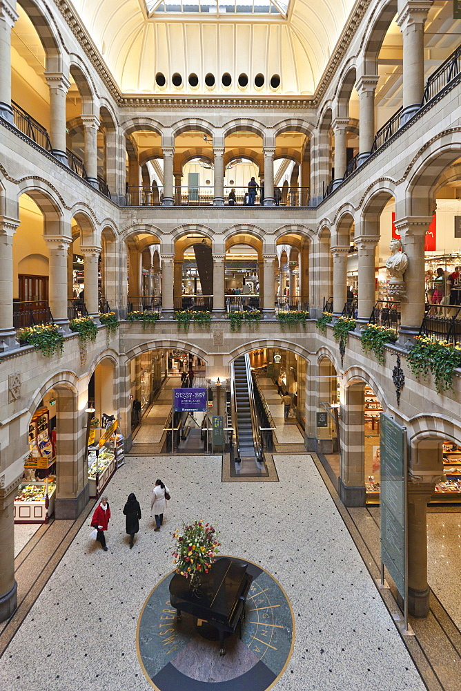 Arcades in the inner courtyard of Magna Plaza shopping centre in the former building of the Main Post Office, Nieuwezijds Voorburgwal, Amsterdam, Holland, Netherlands, Europe