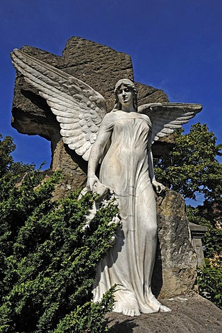 Big statue of an angel on a 19th century grave against a blue sky, Johannisfriedhof cemetery, founded in the 13th century, Brueckenstrasse street 9, Nuremberg, Middle Franconia, Bavaria, Germany, Europe