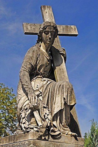 Statue of a woman carrying a cross on a 19th century family grave, Johannisfriedhof cemetery, founded in the 13th century, Brueckenstrasse street 9, Nuremberg, Middle Franconia, Bavaria, Germany, Europe