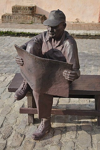 Old man reading a newspaper, sculpture, Plaza del Carmen, historic district of Camagueey, Cuba, Caribbean, Central America