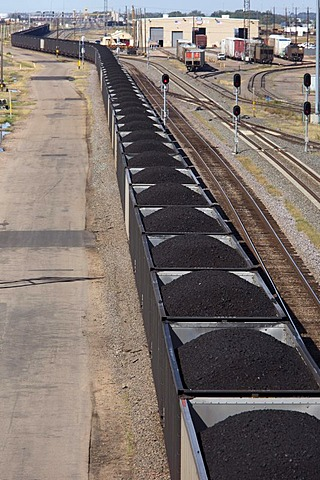 An eastbound train hauling coal from western strip mines passes through the Union Pacific Railroad's Bailey Yard, the largest rail yard in the world which handles 14, 000 rail cars every day, North Platte, Nebraska, USA