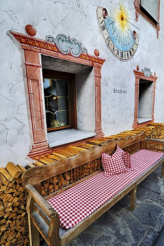 Wooden bench and sundial, Neustift, Stubaital Valley, Tyrol, Austria, Europe