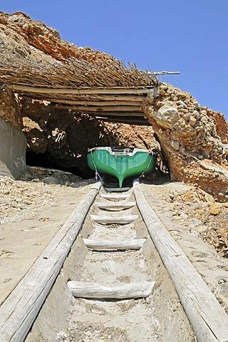 Boat in a boat shed, Cala Benirras, beach, Sant Joan de Labritja, San Juan Bautista, Ibiza, Pityuses, Balearic Islands, Spain, Europe