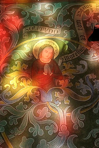 Colourful light through a stained glass window illuminating a religious picture, Ahrweiler, Rhineland-Palatinate, Germany, Europe