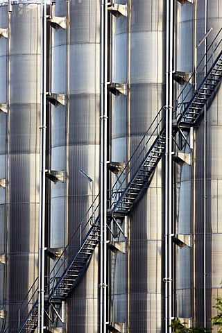Steep stairs leading up stainless steel tanks, chemical industry, storage tanks for chemical products, Germany, Europe