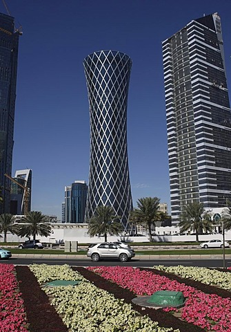 Tornado Tower skyscraper and flower beds along the roadside, West Bay District, Doha, Qatar, Middle East