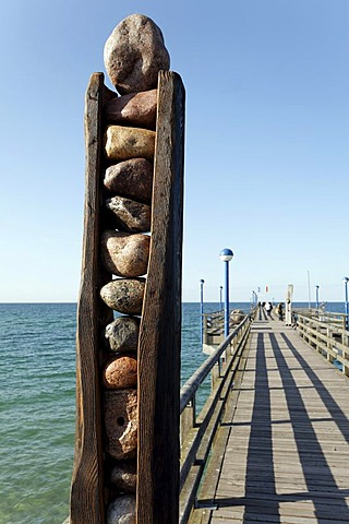 Abstract sculpture on a pier, made of stone and wood by Roland Lindner, Zingst, Fischland-Darss-Zingst, Baltic Sea, Mecklenburg-Western Pomerania, Germany, Europe