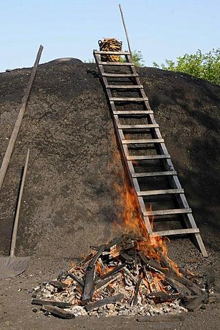 Charcoal kiln is set on fire by charburner, Walpersdorf, Siegen-Wittgenstein, North Rhine-Westphalia, Germany