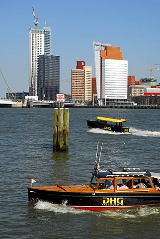 Small watertaxi ferry boats on the Nieuwe Maas River, modern architecture at the Wilhelminapier at back, Rotterdam, Zuid-Holland, South-Holland, Netherlands, Europe