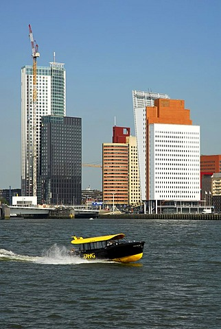 Small watertaxi ferry boat on the Nieuwe Maas River, modern architecture at the Wilhelminapier at back, Rotterdam, Zuid-Holland, South-Holland, Netherlands, Europe