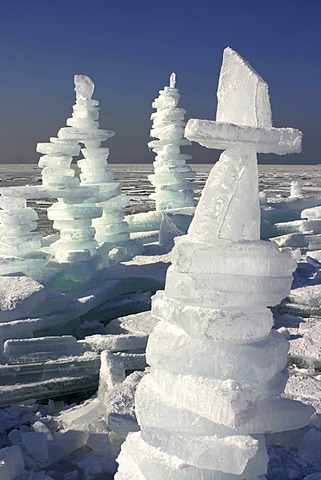 Man-made ice towers on frozen lake Chiemsee, Chiemgau, Upper Bavaria, Germany, Europe