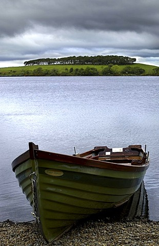 Wooden dinghy on Billberry Lake, County Mayo, Republic of Ireland, Europe