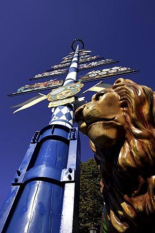 Lion of Bavaria and maypole, Munich, Upper Bavaria, Germany, Europe