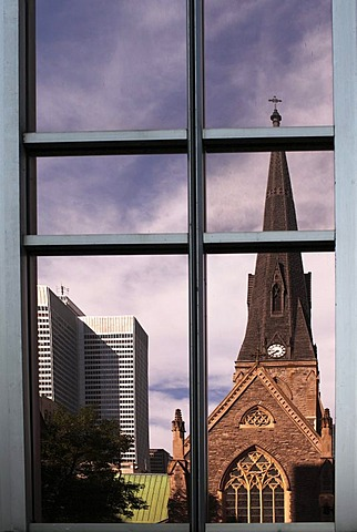 Church reflected in the facade of a high-rise building, Montreal, Quebec, Canada