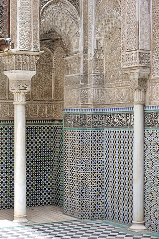 Walls with columns, arabesques and mosaics, Medersa Attarine Koran School, Fez, Morocco, Africa