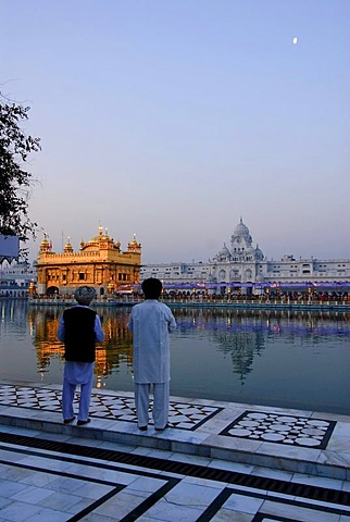 Sikhs looking at the Golden Temple, Amritsar, India, Asia