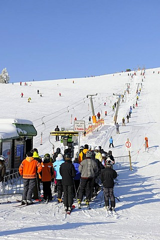 Skilift and skiers on Mt Feldberg, southern Black Forest, Baden-Wuerttemberg, Germany, Europe
