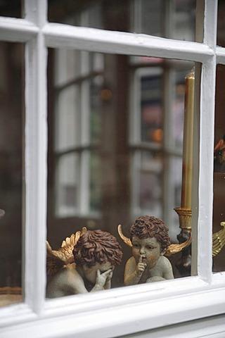Angel figurines in a window
