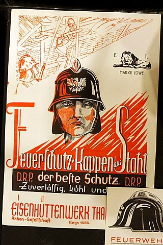 Man with historical steel fire helmet, title illustration of an advertising brochure, Huettenmuseum Thale ironworks museum, Thale, Harz, Saxony-Anhalt, Germany, Europe