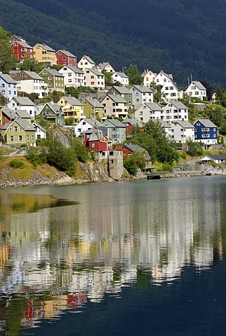 Houses reflecting in the water of the Sorfjord, Odda, province of Hordaland, Norway, Europe