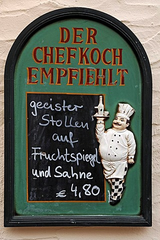 Menu board with cooking figure on a restaurant, Erlangen, Middle Franconia, Bavaria, Germany, Europe