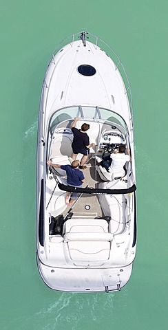 Three men in a motor boat, from above