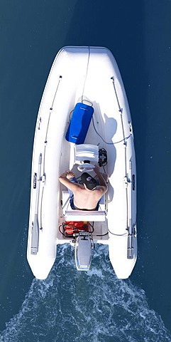 Man in a dinghy, from above