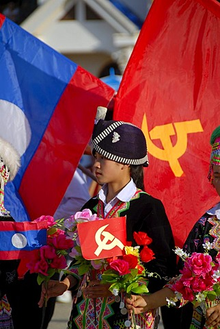 Girl of the Hmong ethnic group, traditional clothes with turban, Lao national flag, flag of the Communist Party, Xam Neua, Houaphan province, Laos, Southeast Asia, Asia