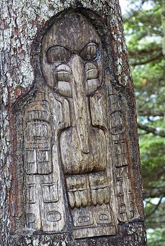 Sign, The Raven clan territory, tree carving, Tlingit Indians, Juneau, Southeast Alaska