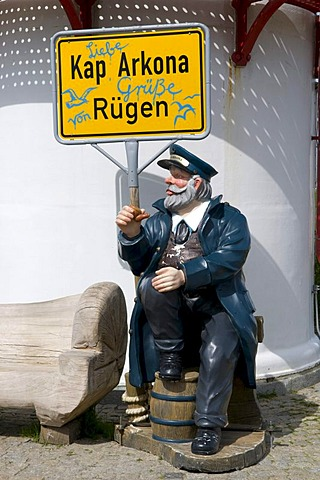 Seaman figure with a town name sign in front of the lighthouse at Cape Arkona, Isle of Ruegen, Mecklenburg-Western Pomerania, Germany, Europe
