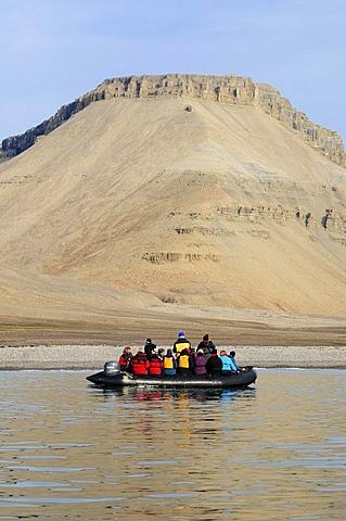 Zodiac with cruiseship passengers near the shore of Devon Island, Northwest Passage, Nunavut, Canada, Arctic