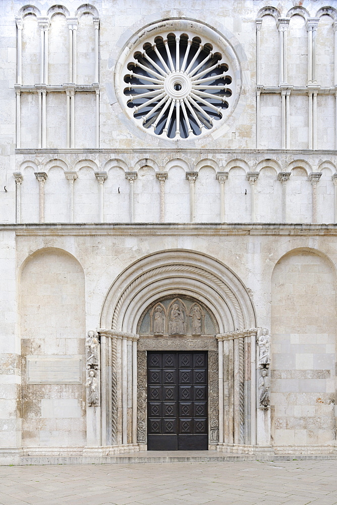 Portals and rosette on the west facade of the Cathedral of St. Anastasia in Zadar, Croatia, Europe
