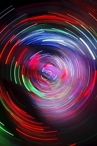 Maze, labyrinth made of colorful illuminated light rods, at a fair