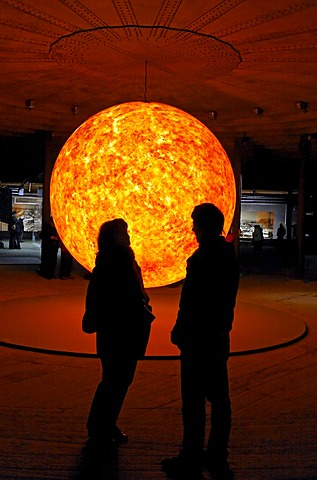 "Two visitors looking at a replica of the sun, glowing ball, exhibition ""Wunder des Sonnensystems"" wonders of the solar system, Gasometer Oberhausen, Ruhrgebiet region, North Rhine-Westphalia, Germany, Europe"