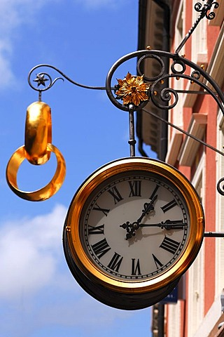 Large clock and two gold wedding rings as a sign outside a jewellery store, Freiburg im Breisgau, Baden-Wuerttemberg, Germany, Europe